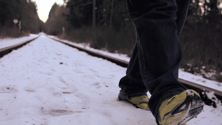 Robert Morales feet on tracks